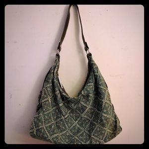 Teal patterned purse with silver details